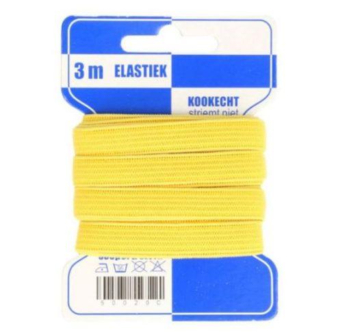 kräftig gelbes Gummiband auf Pappkarte