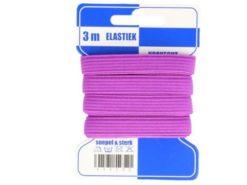 violettes Gummiband auf Pappkarte