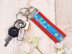 SanDaLu Schlüsselanhänger Monster rot mit Schlüssel